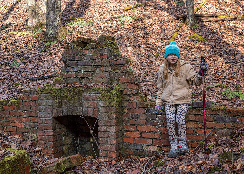 Hailee sitting on an old cabin foundation along the Laurel Draft Trail, Quehanna Wild Area, Cameron County, PA.