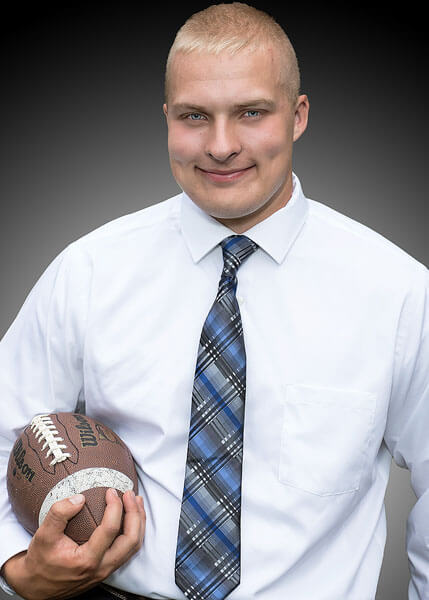 A formal football senior portrait by State College portrait photographer Rusty Glessner