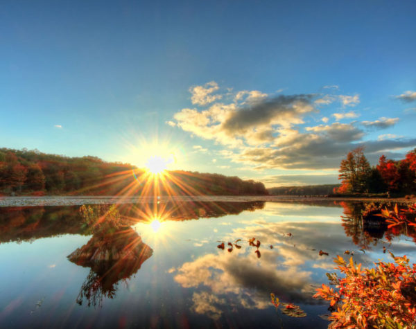 A brilliant sunset is reflected off the waters of Black Moshannon State Park in Centre County, PA.