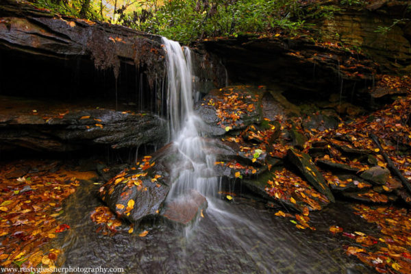 Fall foliage around the upper tier of the Cave Falls on Cole Run, Forbes State Forest, Somerset County, PA