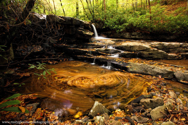 Swirling autumn leaves at Upper Jonathan Run Falls - Ohiopyle State Park.